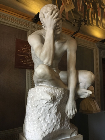 frustrated man statue